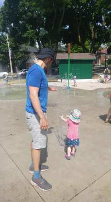 father daughter park splash pad sprinkler water fun