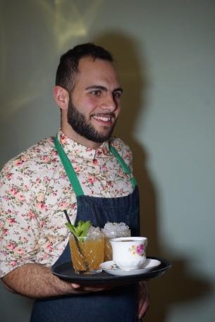 Bartender holding cocktails